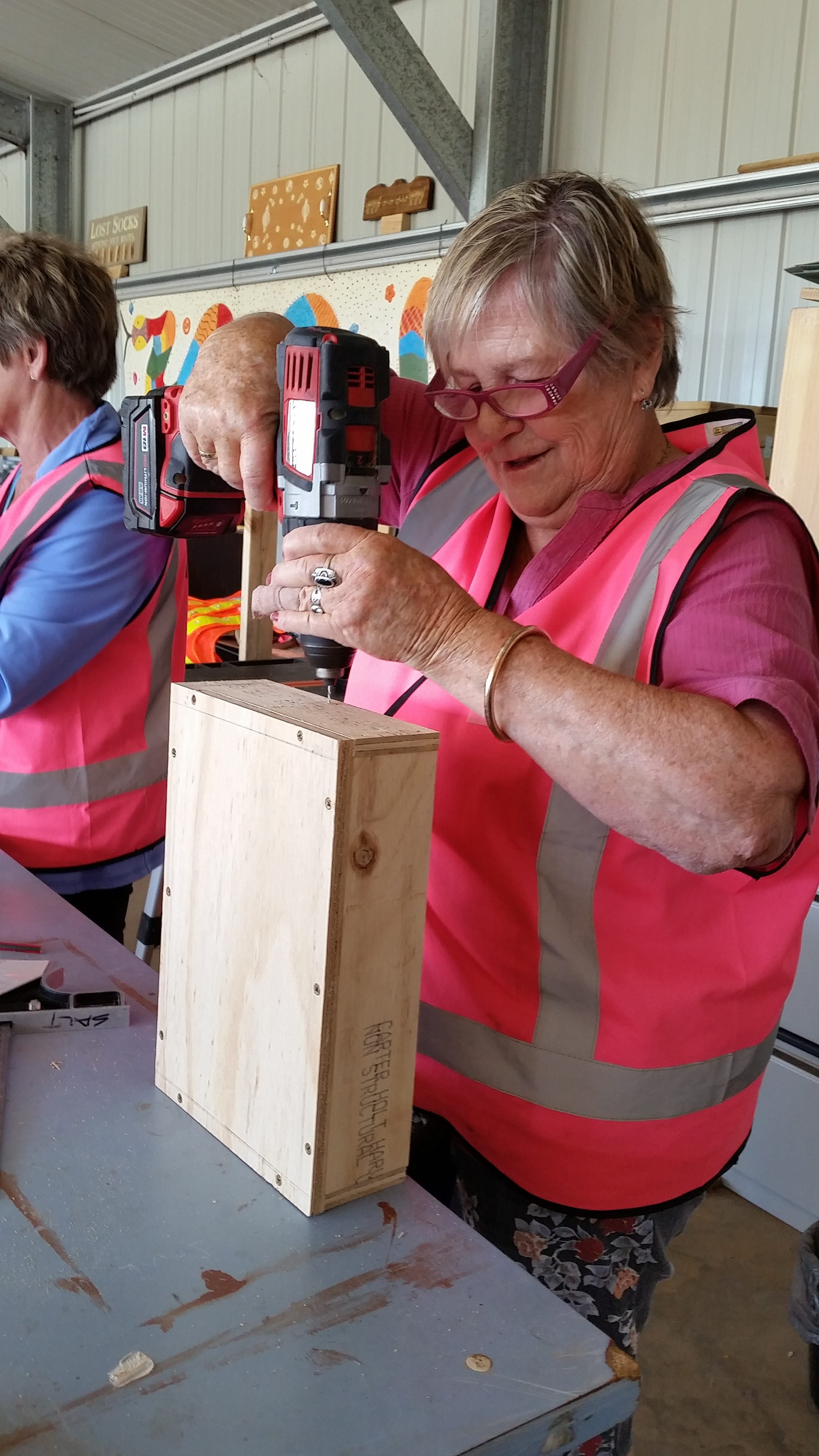 Grand Opening Orange Woman's Shed